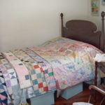 child's bed with quilts