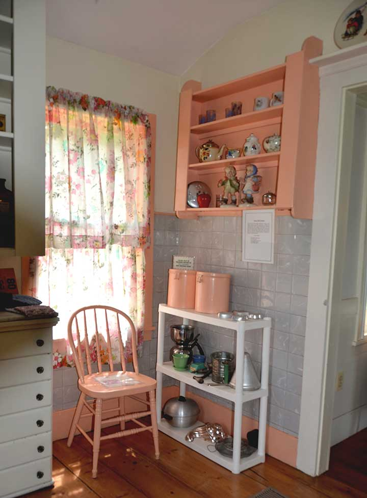 1890s kitchen with gray tile and pink accents