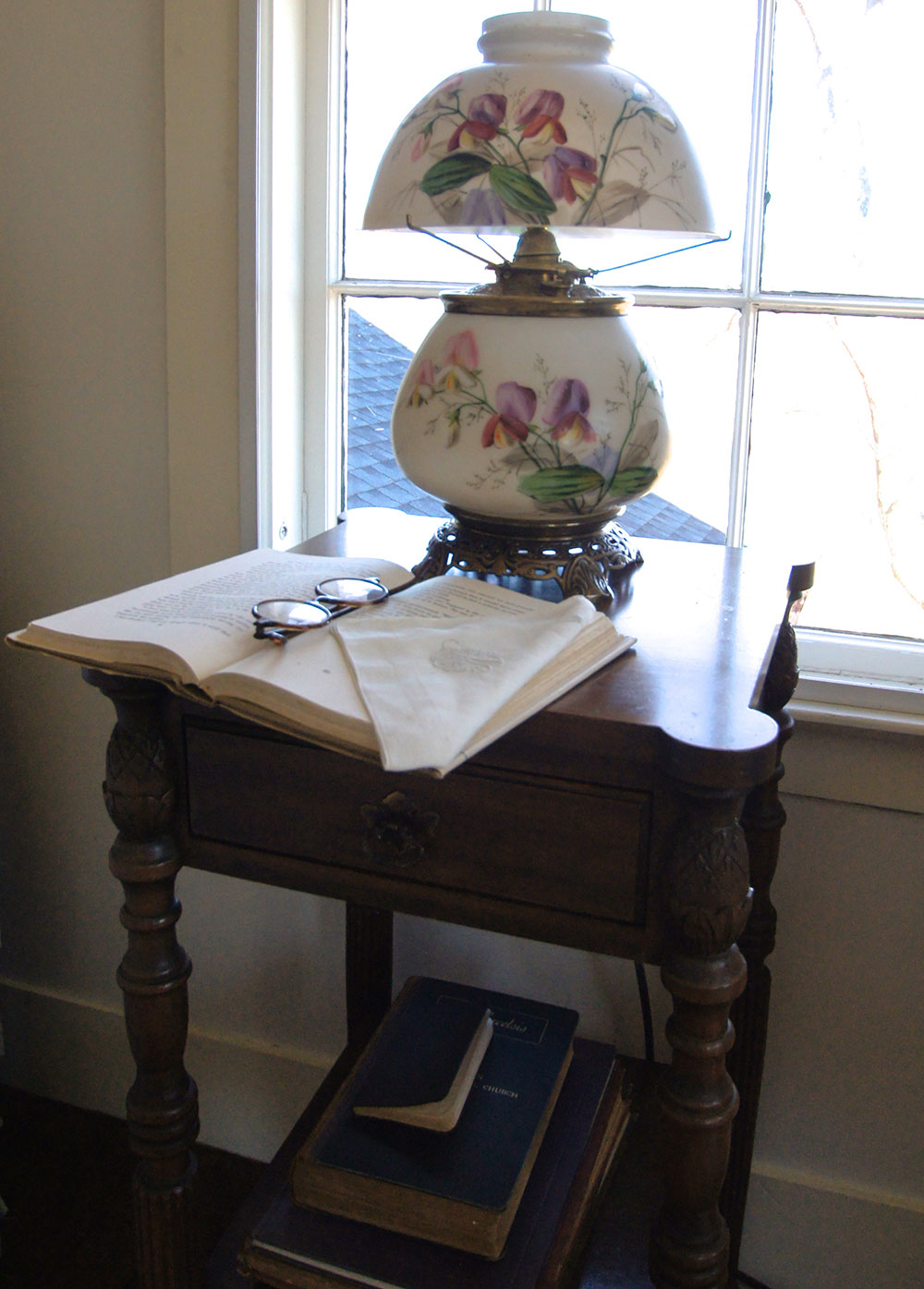 Old glass kerosene lamp on a small table. (photo courtesy Judy Weaver)